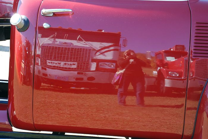My reflection in red truck