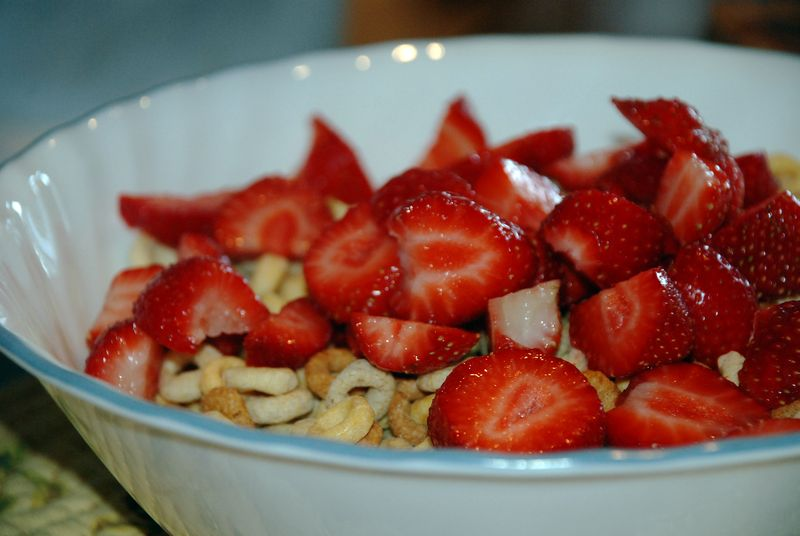 Fresh strawberries on cereal